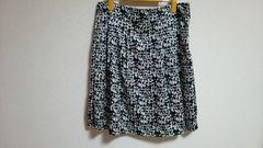 新品:ウエスト80�p:黒×白柄サテン生地スカート