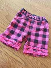 ピンクに黒派手ブロックチェックリボンフリル付パンツ80サイズ