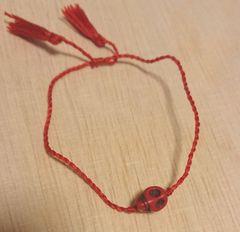 赤色スカルモチーフ紐ブレスレット 新品未使用